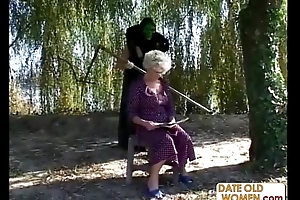 Granny receives a ascription from masked chap